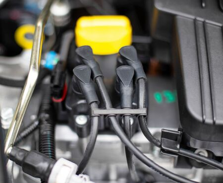 distributor in a car with high-voltage wires in the engine compartment, background, closeup