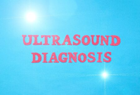 Inscription ultrasound diagnosis in red letters on a blue background. The concept of examination of human organs and the detection of diseases using ultrasound.