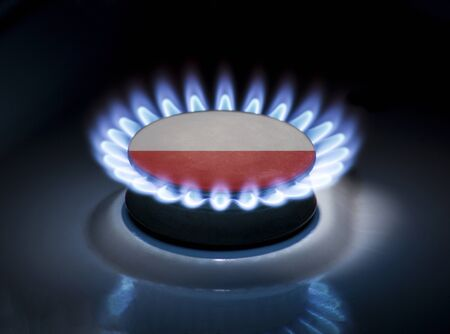 Burning gas burner of a home stove in the middle of which is the flag of the country of Poland. Gas import and export delivery concept, price per cubic meter, transit, background, gasoline