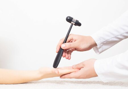 The doctor checks the palmar chin reflex in the palm of the patient. Verification and treatment of vegetative vascular dystonia and Parkinson's disease, copy space, skin reflex