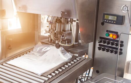 The automatic process of making confectionery food cream for adding to cakes and sweet products, desserts. Packing ultra-pasteurized cream in bags