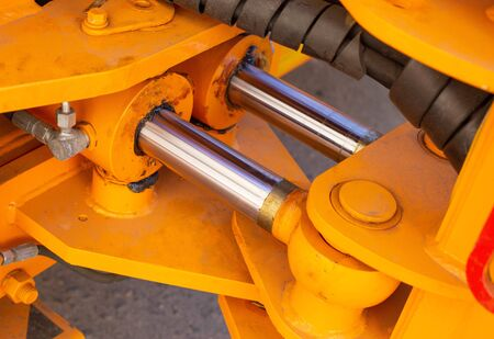 Powerful hydraulic pumps that stand in the bucket of an excavator, industry, close-up