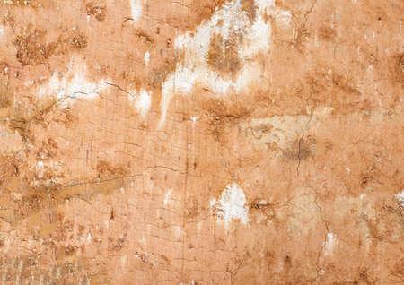 Clay soil background, orange soil closeup