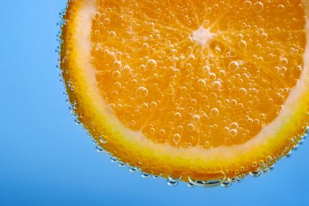 bubble acid: Fresh sliced orange fruit with bubbles