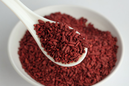 Red yeast rice on white spoon