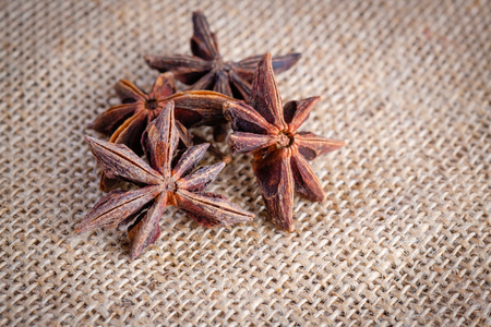 anis: Star anise on rustic sack Stock Photo