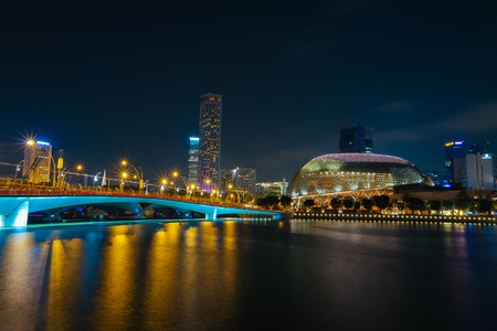 Singapore Marina bay, August 27, 2015: Singapore cityscape over the bay during night time with Esplanade theater architecture and other buildings