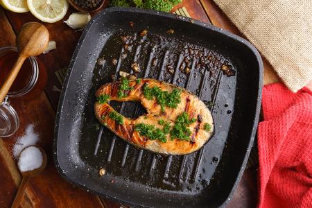 Pan grilled salmon steak top view