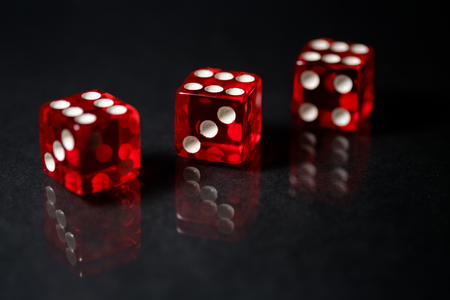 Red Sic Bo dice with black background