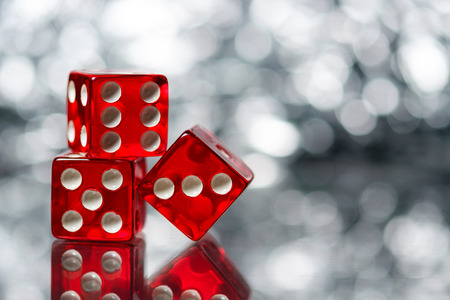 Red Sic Bo dice with sparkling background Stock Photo