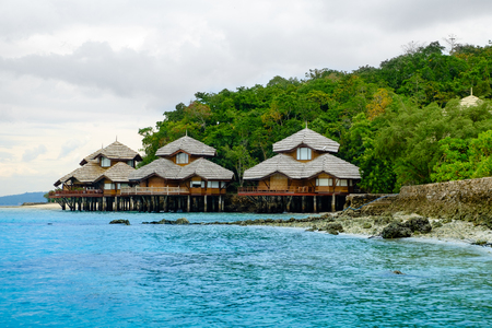 Samal island of Davao, Philippines: August 23, 2016: Pearl farm beach resort view with its huts on clean sea side