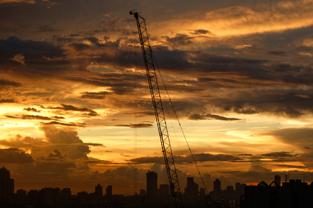 Crane high rise during sunset in Manila, Philippines