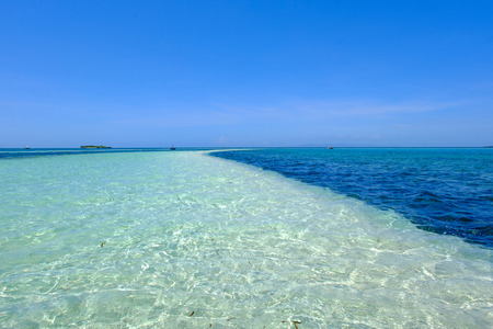 Shallow water over the long sand bar in virgin island of Bohol, Philippines