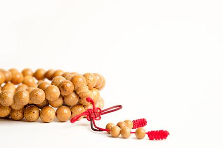 Praying and reciting beads Stock Photo