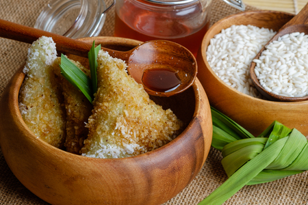 Lupis cake or Kue Lupis from Indonesia in wooden bowl