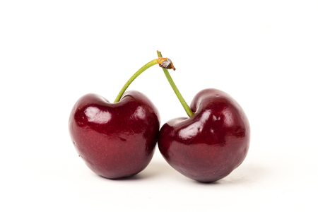Two cherries fruit on white background