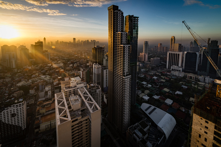 Manila, Philippines. 2016 Feb 21: Early morning at Manila city taken from a high rise condominium with sun rays passed through buildings Redactioneel