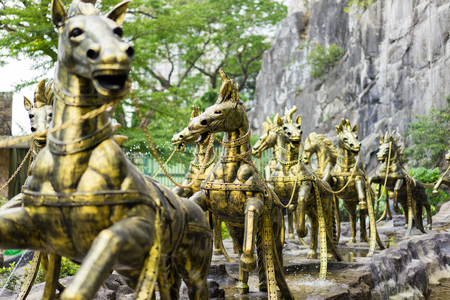 Gombak, Selangor - Malaysia. 2017 Sept 01: Horse chariot statue that drawn Krishna which located in front of Ramayana Cave in Batu Cave area
