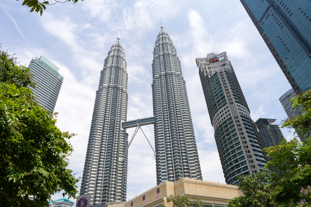 KLCC area of Kuala Lumpur - Malaysia. September 1 - 2017: The Petronas Towers which also known as the Petronas Twin Towers, are the famous twin skyscrapers in Kuala Lumpur of Malaysia