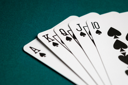 Royal flush combination cards on Poker game 写真素材