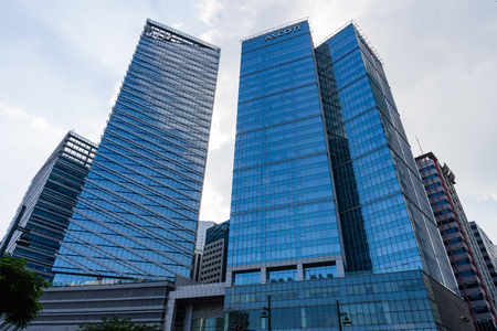 Ascott apartment hotel building in Bonifacio Global City of Philippines. October 27, 2018: Low angle view of high rise Ascott hotel apartment during the day Редакционное