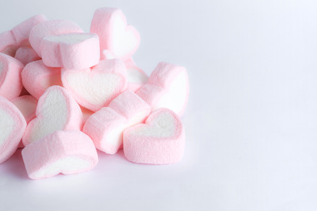 Heap of love shape marshmallow on white background