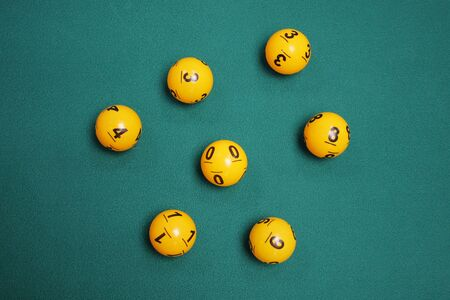 Lotto balls with number on green background for online casino concept