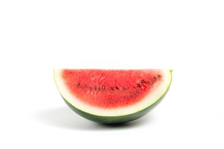 Fresh ripe and red watermelon fruit with seeds on white isolated background