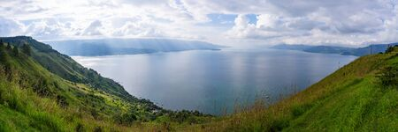 Panoramic view of Lake Toba from Smiling Hill or Bukit Senyum in Bahasa. North Sumatra - Indonesia as one of the biggest volcanic lake