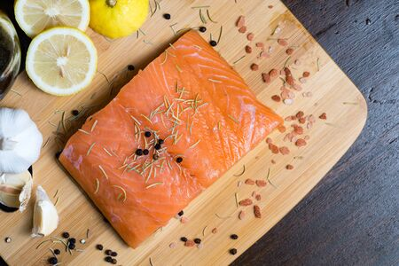 Big chunk of Salmon fillet with its ingredients