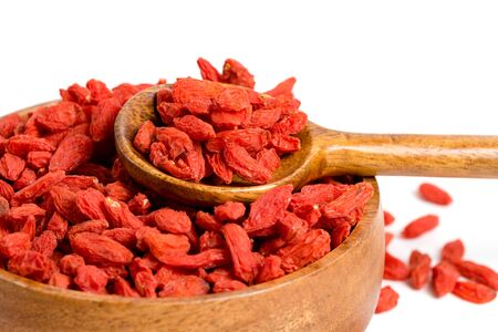 Dried goji, goji berry or wolfberry on wooden spoon as one of the famous antioxidant superfood