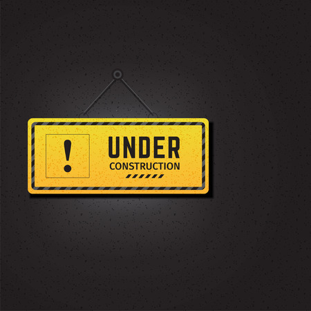 Under construction sign in black background Фото со стока - 123982472