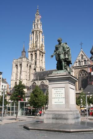 Faces of Antwerp: Rubens statue with cathedral in the background photo