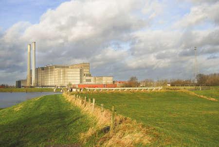 powerstation: Power station beneath threatening sky in Holland Stock Photo