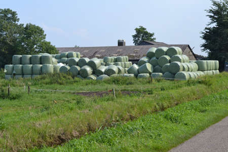 barns winter: hay bales near a farm in the Netherlands