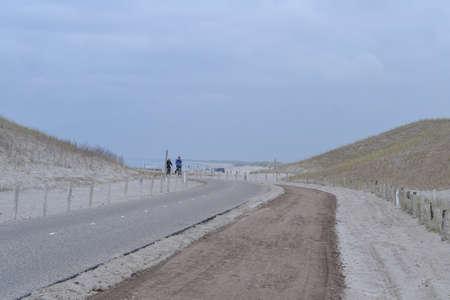 raod: bikers biking on raod in the Dutch dunes