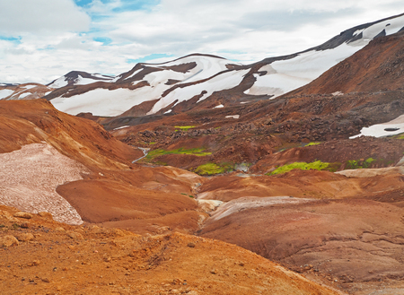 colourfull rhyoliet Kerlingarfjöll volcanic mountains in geothermal area in iceland with snow tangues and green moss