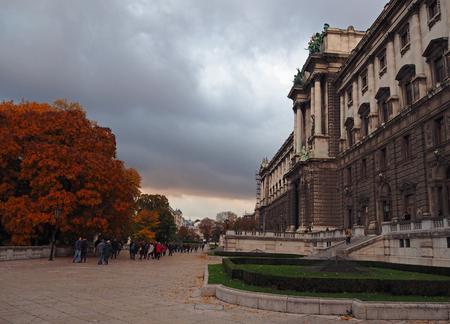 Autumn street view with Schönbrunn Castle in Vienna in cloudy evening Editorial