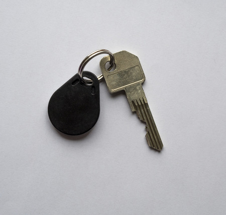 single security door key with chip on white background Stock Photo