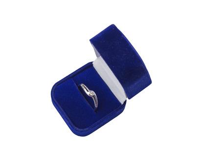 diamond ring: Single diamond engagement ring in blue velvet box on isolated white background
