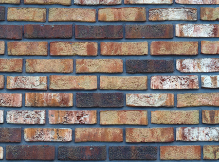 colorful new vintage red orange white brick wall Stock Photo