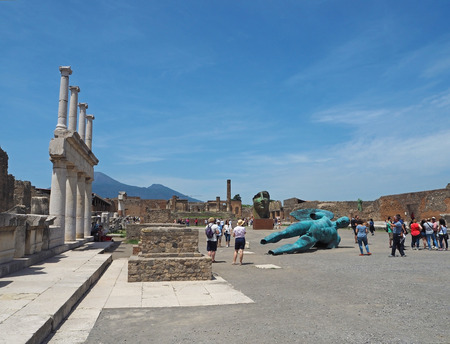 ITALY, POMPEII, MAY 26, 2016: Group of tourist looking around on Pompei  forum  square in hot sunny day