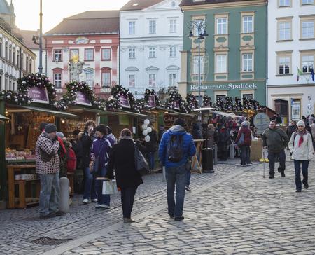 BRNO, CZECH REPUBLIC, DECEMBER 14, 2018: Christmas market on Zelny Trh, Market square with stand stall in Moravia capital city centre with shopping local and tourist people and christams decoration, Parnas fountain and Cathedral of St. Peter and Paul, lat