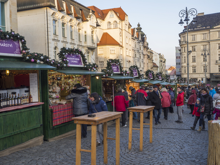 BRNO, CZECH REPUBLIC, DECEMBER 14, 2018: Christmas market on Zelny Trh, Market square with stand stall in Moravia capital city centre with shopping local and tourist people and christams decoration, late afternoon