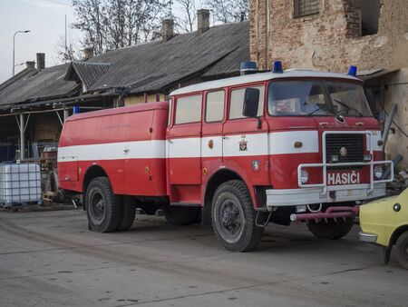 Beroun, Czech Republic, March 23, 2019: red firefighters truck veteran standing on courtyard of Beroun brewery called Berounsky medved Editorial