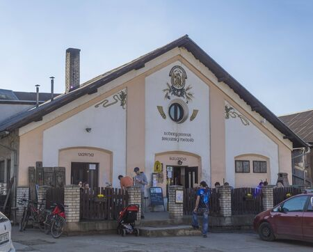 Beroun, Czech Republic, March 23, 2019: building of brewery pub called Berounsky medved in central Bohemian with relaxing people Editorial