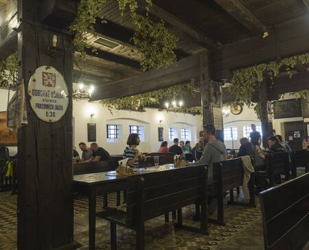 Beroun, Czech Republic, March 23, 2019: Interior of old rustic traditional brewery pub called Berounsky medved in central Bohemian with relaxing people