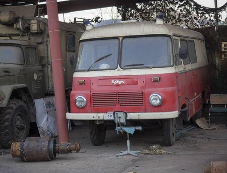 Beroun, Czech Republic, March 23, 2019: abandoned red emergeny truck veteran robur standing on courtyard of Beroun brewery called Berounsky medved