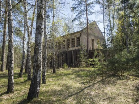 Czech Republic, Ralsko, April 26, 2019: Abandoned ruined house building at former Soviet army military training range area in the middle of woods Éditoriale