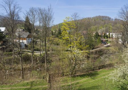 View on Village Hejnice with cottages and creek in spring, Hejnice, Jizera mountain, Czech Republic